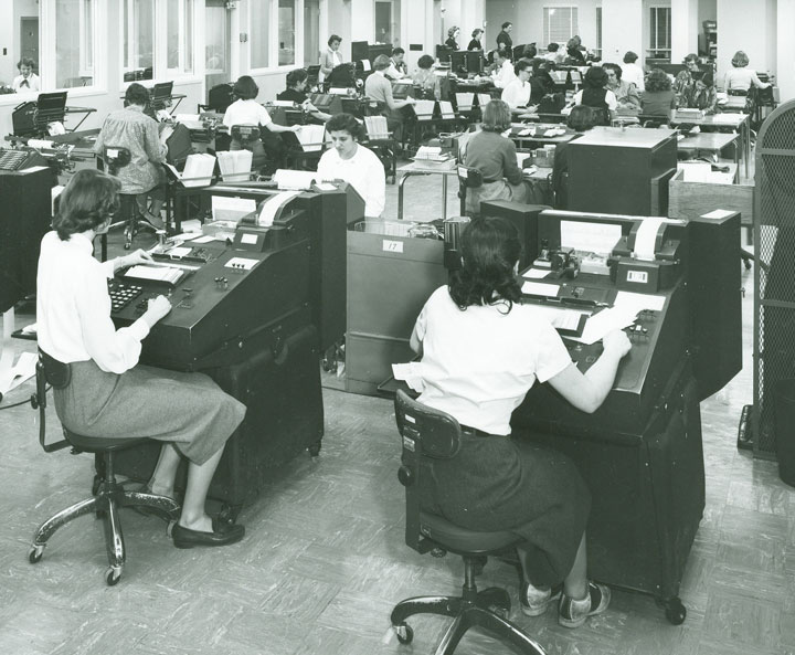 Women working at account ledger posting machines in the 1950s, M&I Bank, Wisconsin.